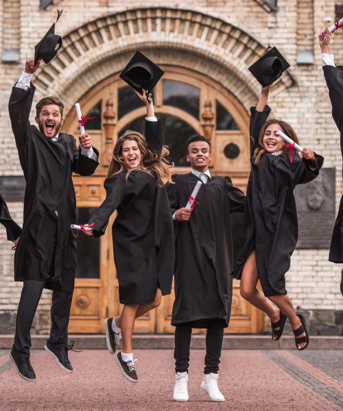 Successful,Graduates,In,Academic,Dresses,Are,Holding,Diplomas,,Looking,At